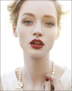 Beautiful, muted makeup, dark red lip.