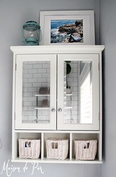 mirrored medicine cabinet above the toilet - saves space and makes the bathroom feel roomier with reflective mirrors and the ability to have a larger mirror above the sink!