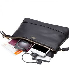 Bond Charging Leather Power Purse in Black   KNOMO   Wherever the night may take you, always prepared and charged to seize the next opportunity. Fashion and practicality combine, enhancing your look and giving you the freedom to be truly spontaneous — the perfect companion for a stylish socialite