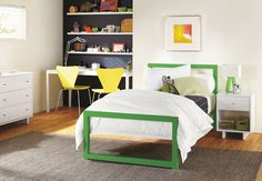 love the bed, dark wall w/ shelves and desk, and of course the yellow chairs!