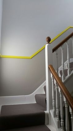 Grey stairs with a zap of yellow. Farrow and ball yellow cake, Ammonite and Purbeck Stone. Yellow Hallway, Yellow Stairs, Grey Hallway, Hallway Colours, Wall Colors, Paint Colors, Dado Rail Hallway, Hallway Paint, Sweet Home