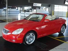 Lexus SC 430 Hardtop Convertible  All Black with peanut butter leather seats and fully loaded. Before I get married