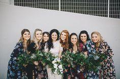 Bridesmaids in mismatched floral dresses