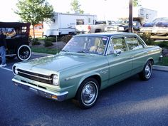 I think I was in my 20's when I drove this 1968 American (later AMC) Rambler.  Just like this one.  Even the hubcaps!