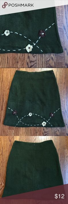 Green skirt Totally darling skirt. It used to be part of a set but I didn't like the top and got rid of it it a long time ago. Darling embroidery and flower details. Soft lining. Feel free to ask questions. Skirts