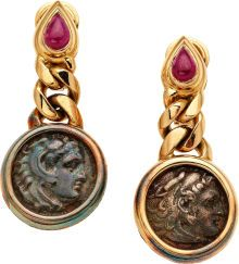 Ruby, Ancient Coin, Gold Earrings, Bvlgari The earrings feature pear-shaped ruby cabochons, one measuring approximately 6.71 x 5.08 x 2.90 mm and weighing approximately 0.95 carat, the other measuring approximately 6.78 x 4.55 x 3.01 mm and weighing approximately 0.90 carat; and two bezel-set ancient coins, set in 18k gold, marked Bvlgari. Gross weight is 30.70 grams
