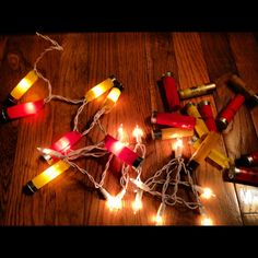 Spent shotgun shells + strand of Christmas lights + hot glue = perfect country Christmas tree lights or man cave/ camp must haves!