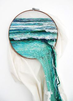 Using embroidery, yarn, and and wool artist Ana Teresa Barboza creates landscapes and other imagery that exists in the space between tapestry and sculpture. Mimicking the flow of waves or grass, each
