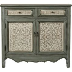 Imbue any atmosphere with timeworn elegance and classic whimsy with this eye-catching wood cabinet, featuring an antique blue/white finish and molded details. Set it in the dining room to round out your refined entertainment space, then open up its cabinet doors and single drawer to stow away plates, platters, and other serveware in simple style. Defined by striking carved panels with bold floral scrollwork, this design brings a dash of definition to any ensemble. Let it play with scroll...