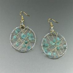 Dramatic Apatite Wire Wrapped Silver Earrings Shown on https://www.johnsbrana.com/apatite-wire-wrapped-earrings.html  #JohnSBrana #AluminumAnniversary