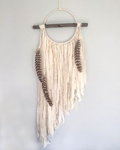 Bohemian Dream Catcher - Dream Catcher Wall Hanging with Turkey Feathers - Branch Decor - Boho Dreamcatcher - Large Dream Catcher The Ophelia dreamcatcher is a stunning and dramatic wall hanging. Attached to the front of the ring is a beautiful straight branch that adds visual