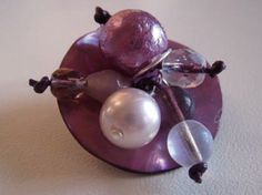 Pearls on the top of a purple button...that's a wonderful ring!