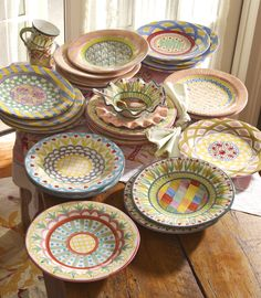 We love flowers and we include them in so many of our designs. Look closely at these hand-painted majolica plates.
