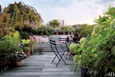 Hairstylist Guido Palau's Artful Manhattan Duplex, The terrace was created by Jane Kim Design, which oversaw renovations of the brownstone apartment, and Parrotta Design Management was responsible for the landscaping.