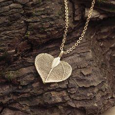 Gold finish skeleton leaf pendant