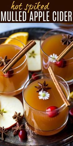 Easy Hot Spiked Mulled Apple Cider a fun cocktail for the holiday season! This Mulled Cider is filled with cinnamon sticks, star anise, clove, all spice, fresh oranges and a spiced rum to warm you right up! #crockpot #glutenfree #alcoholic #thanksgiving #