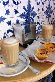 The Portuguese Galao (1/4 espresso, 3/4 foamed milk in a tall glass) with Pastel da Nata.  Perfect coffee break...for thoose that don't do coffee chocolate may b substituted