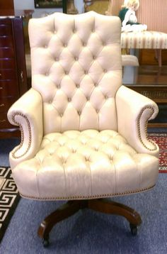 this sophisticated classic french style button back chair would be