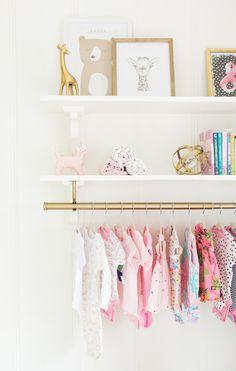 tiny clothing rack in a nursery!
