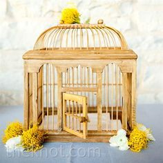 love this wooden bird cage, but without all those flowers.