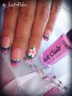 Pink and black french tips with dotted border and flower on ring finger.
