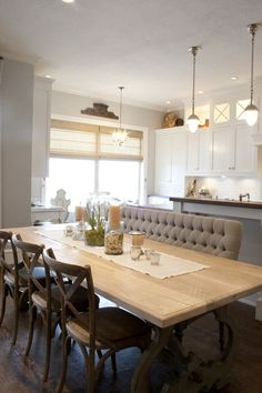 Dining open to kitchen, large banquet/settee for seating closest to kitchen, kitchen cabinetry