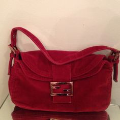 """Authentic FENDI, Passaspalla velluto/rosso hobo Absolutely stunning burgundy color fall bag !! Comes with authenticity card, corduroy like material, Rose gold fold over flap top magnetic closure!! Adjustable straps,  beautiful hardware, interior lining Fendi logo with me side zip pocket, strap drop 9 inches, measurements are 10"""" x 6"""" x 2"""" approximate!  This Fendi bag looks new,has little wear on flap closure right at the end corners not noticeable! though I DO have a pet free/smoke free…"""
