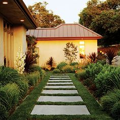 23 small yard design solutions | Glowing entry | Sunset.com