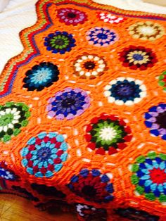 Crocheted kaleidoscope afghan with orange by KnottyMeCrochet, $150.00