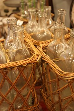 glass bottles in wicker case :: great for displays of all sorts.