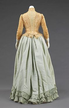 The bustle silhouette, although primarily associated with the second half of the 19th century, originated in earlier fashions as a simple bump at the back of the dress, such as with late 17th-early 18th century mantuas and late 18th- early 19th century Empire dresses