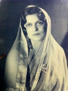 Maharani of Cooch Behar Indiraraje, mother of Rajmata Gayatri Devi in her full signature style of French chiffon and pearls . This portrait was taken in a studio in Paris in the 1930's.