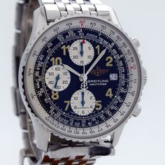 2000's Breitling Navitimer Ref. A13022 Stainless Steel 3 Register Chronograph watch with Original Black Dial with Luminous Arabic Numbers and Original Stainless Steel Breitling Bracelet. Triple Signed