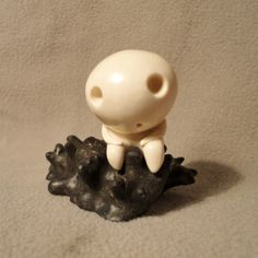 A kodama is a spirit from Japanese folklore, which is believed to live in certain trees (similar to the Dryad of Greek myth).  Cutting down a tree which houses a kodama is thought to bring misfortune, and such trees are often marked with shimenawa rope.