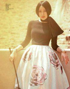 Model Qin Lan, photographer Yin Chao for Vogue, China, July 2013