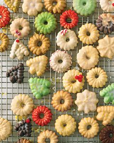 Glazed Spritz Cookies - These are really great recipes for Spritz Cookies! I love Spritz Cookies because they are a little lighter and the cookie press provides awesome shapes making them look like they were a ton of work but they are so simple and easy!