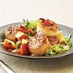 Seared Scallops with Bacon, Cabbage, and Apple by Cooking Light. Seared Scallops with Bacon, Cabbage, and Apple is a quick but hearty entrée that goes great when served with roasted potatoes.
