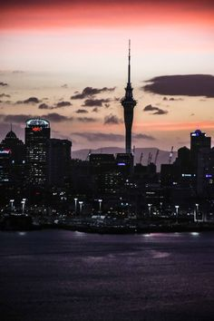 Sunset at Devonport, Auckland with cloud touching sky tower standing tall ! Visit my travel diaries at richagandhi.co.nz . #sunset #skytower #auckland #nz #newzealand  #devonport