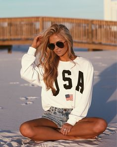 Summer time all American look || distressed denim jeans shorts and USA sweatshirt beach look | instagram: @SheaLeighMills
