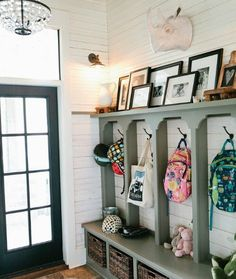 A Cubby Per Kid-- I would have put hooks on the inside of the vertical planks though, and made the planks deeper to accommodate a hanging jacket (for a total of 3 hooks per kid).