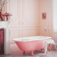 Really want to drink champagne in this unapologetically girlie bathroom #pamper #bathroom #bubbles #blush #pink #fireplace #interior #design #interiordesign