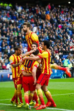 Players of FC Barcelona celebrate after Lionel Messi scored the opening goal with a penalty during the La Liga match between RCD Espanyol and FC Barcelona at Cornella-El Prat Stadium on March 29, 2014 in Barcelona, Catalonia.