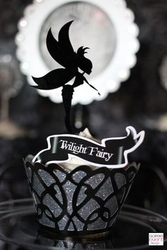 "Custom acrylic laser cut ""Twilight Fairy"" Cupcake Toppers from Ten23 Designs and Glittered Cupcake Wraps from Dress My Cupcake as seen in ""Twilight Fairy's Hollow"" party designed by Soiree Event Design"