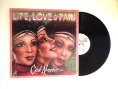 Club Nouveau ‎– Life, Love & Pain  Label: Warner Bros. Records ‎– 1-25531, Warner Bros. Records ‎– 9 25531-1 Format: Vinyl, LP, Album Country: