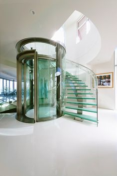 Nice! A glass elevator with wrap around stairs in your home.