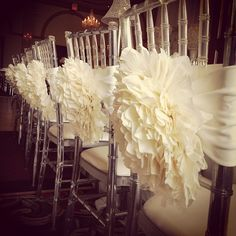 Flower Chair Sashes on Ghost Chivari Chairs. Photo by rachelaclingen