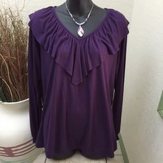 a.n.a blouse Great long sleeve purple ruffled neck top, great condition, 65% polyester and 35% rayon, nice looking top. a.n.a Tops Blouses