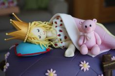 This is the princess and the pea fairy tale cake I made for my daughter's 4th birthday. This pic shows the detail of the cake toppers. My OCD is showing, even though the princess is covered to the shoulder, she is a proper person complete with hand painted nightie underneath the blankets. Pink Bear is my daughter's favourite bed time soft toy.