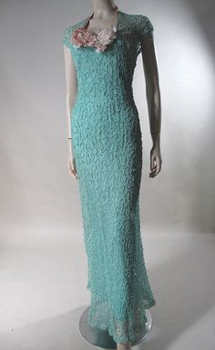 1930's evening gown in turquoise tulle covered with couched turquoise rayon ribbon-work and embellished with pink ribbons and flowers.