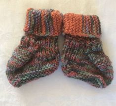 Ugg boots stay on the little one's feet better than booties do. These ugg boots are knit in orange with mottled and green, grey, pink, ginger wool. Pink Ginger, Baby Uggs, Grey Goose, Angela White, Orange, Main Colors, Ugg Boots, Color Mixing, Little Ones